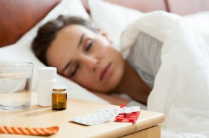 Woman lying in bed having autumn flu