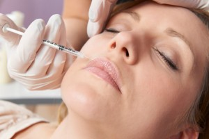 Injection In Lips of Botox Cosmetics  As Beauty Treatment